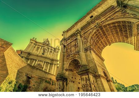 Arch of Septimius Severus and church of Santi Luca e Martina at the Roman Forum. Rome Italy at morning light.
