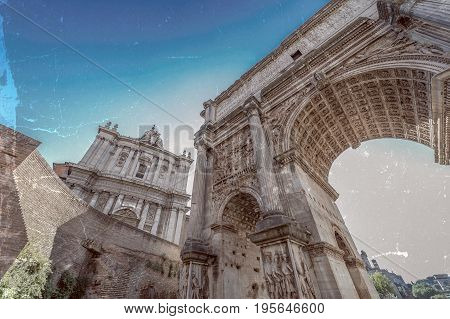 Old photo with Arch of Septimius Severus and church of Santi Luca e Martina at the Roman Forum. Rome Italy. Vintage processing.