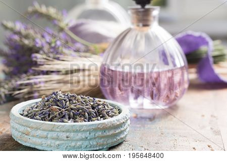 Nature cosmetics handmade preparation of essential oils perfume creams soaps from fresh and dried lavender flowers French artisanal boutique home style