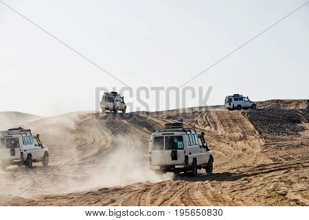 Cars Bashing Through Sand Dunes In Desert