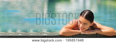 Swimming wellness resort spa woman relaxing banner in luxury retreat infinity pool hotel. Tropical travel destination getaway for relaxation and body care, hydrotherapy.