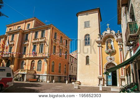 Vence, France - July 13, 2016. View of the city hall's building and church in Vence, a stunning medieval town completely preserved. In Alpes-Maritimes department, Provence region, southeastern France