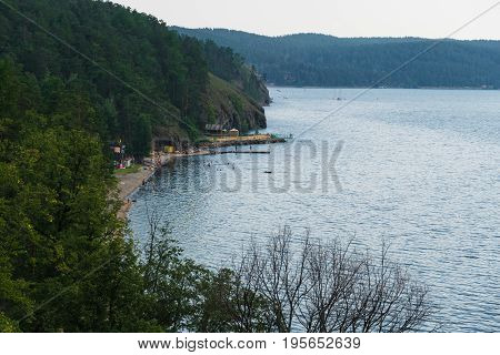 Beach recreation center located on the coast of the lake. View from the height of the mountain.
