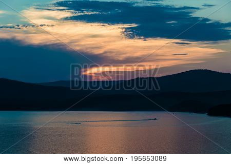 Lake Turgoyak at sunset from the height of the mountains. The lake is located between the mountains of the Ural range.
