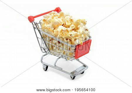 shopping cart with popcorn on a white background