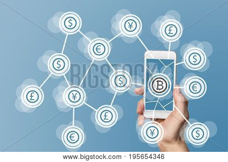 Blockchain and bitcoin technology and mobile computing concept on blue background