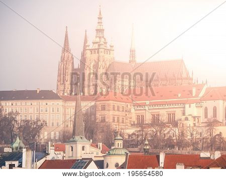 Towers of Saint Vitus Cathedral on Prague Castle illuminated by sun, Prague, Czech Republic.