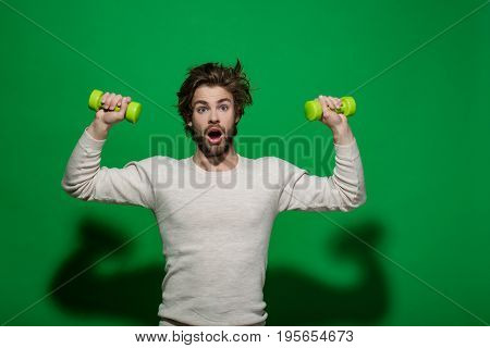 Surprised Man With Barbell Doing Morning Exercise, Has Uncombed Hair