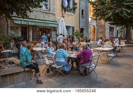 Vence, France - July 13, 2016. Elderly people in bar in the late afternoon in Vence, a stunning medieval town completely preserved. In Alpes-Maritimes department, Provence region, southeastern France