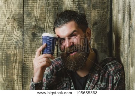 Happy Brutal Man Smiling With Blue Plastic Cup