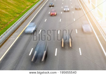 Moving Cars On A Multi-lane Road Asphalt Let The Markingsmoving Cars On A Multi-lane Road Asphalt Le