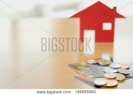 Real estate investment by credit card, House and coins