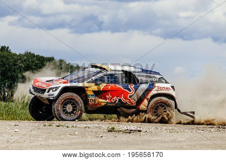 Filimonovo Russia - July 10 2017: rally car Peugeot turn dust road during Silk way rally