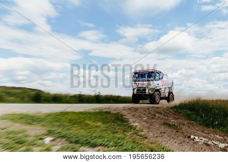 Filimonovo Russia - July 10 2017: blurred motion truck rally car Renault driving on dust road during Silk way rally