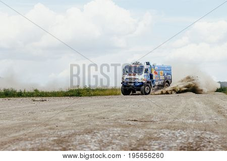 Filimonovo Russia - July 10 2017: truck rally car KAMAZ turn on a dust road during Silk way rally