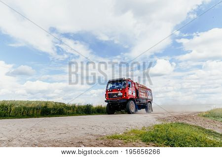 Filimonovo Russia - July 10 2017: truck rally car MAZ driving on dust road during Silk way rally