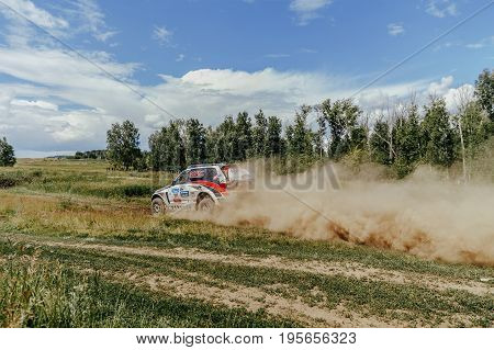 Filimonovo Russia - July 10 2017: russian crew of riders is riding in a rally car during Silk way rally
