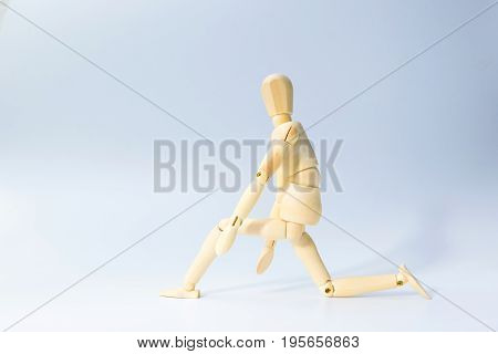 Wooden figure doll with prepare to run emotion for start up business concept on white background.