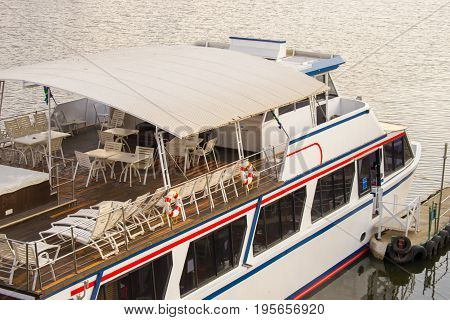Luxury boat top view for cruises on the river with chairs tables and hot tub on the upper deck