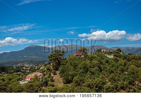 Panoramic View of hills, rooftops and blue sky in Haut-de-Cagnes, a pleasant village on top of a hill, near Nice. Located in the Alpes-Maritimes department, Provence region, southeastern France