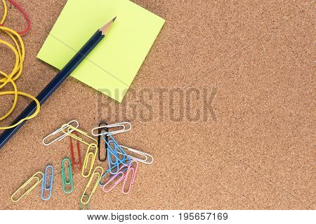 Background image of paperclips, note paper and rubber bands