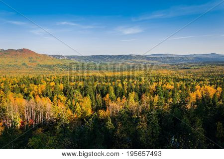 The beginning of autumn from the height of the mountains. Taganay. The Ural ridge.
