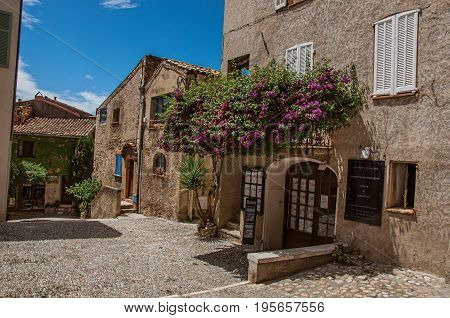 Haut-de-Cagnes, France - July 14, 2016. View of house with flowered bindweed in Haut-de-Cagnes, a pleasant village on top of a hill. In Alpes-Maritimes department, Provence region, southeastern France