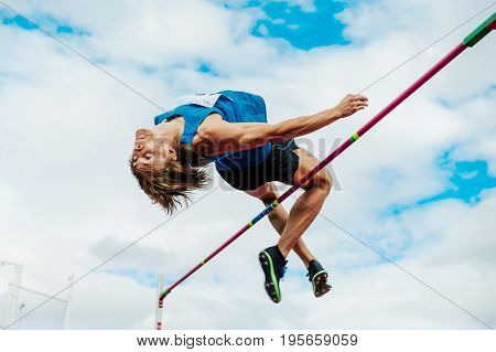 Chelyabinsk Russia - July 7 2017: male athlete high jumper successful attempt during Ural Championship in athletics