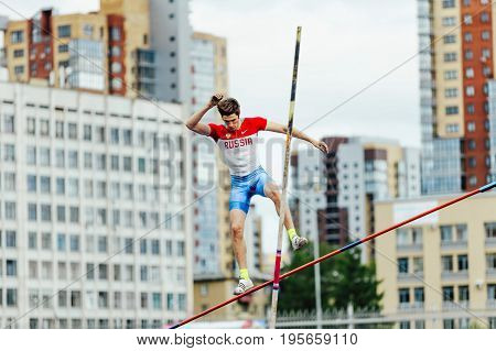 Chelyabinsk Russia - July 7 2017: russian athlete jumper failed attempt pole vault during Ural Championship in athletics
