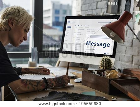 Woman composing an email on a digital device