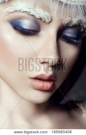 Art beauty girl portrait eyelashes and makeup. Pure skin skin care and eyelashes. Woman in Russian national dress and tiara. Fashion makeup on face