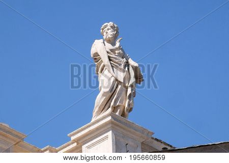 ROME, ITALY - SEPTEMBER 02: St Leonard, fragment of colonnade of St. Peters Basilican - the world largest church, is the center of Christianity in Rome, Italy on September 02, 2016.