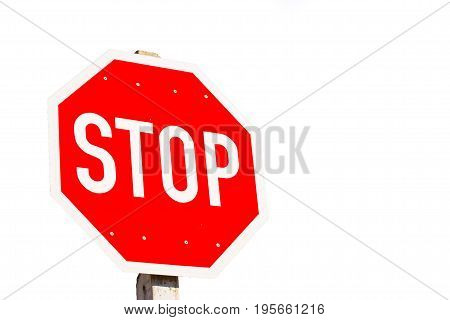 Red stop sign isolated on white background with copy-space