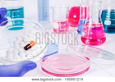 Scientist analyzing pills in medical laboratory. Analysis of medicaments in laboratory. Medical Research and diseases Science.