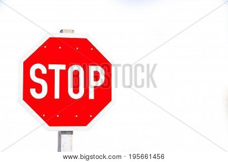 Red octagon shape stop sign on white background wit copy-space