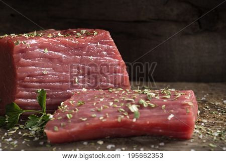 Meat food - raw beef fillet with parsley on cutting board