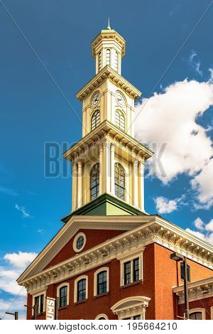 Baltimore Maryland USA - July 8 2017: Clock tower on the restored Camden Station originally built in 1856. The building now houses the Sports Legends Museum.