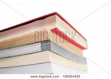 Stack of used books isolated on a white backdrop