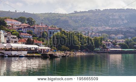 Cityscape view of balchik city houses and apartment buildings on the hills of black sea coast in Bulgaria.