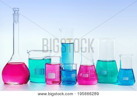 Chemical and Medical laboratory research. Chemical glassware with colorful liquids and reagents. laboratory beakers and glassware