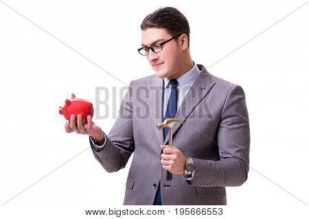 Businessman breaking piggybank isolated white background