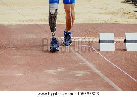 leg athlete handicap long jump track stadium