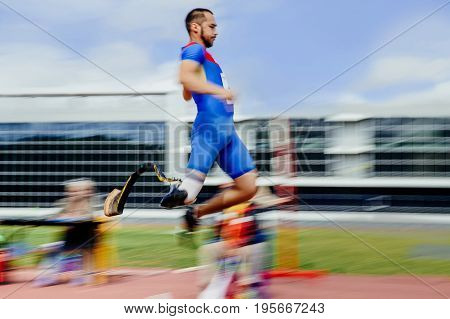 blurred motion long jump man athlete disabled