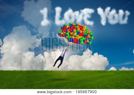 Man flying balloons in romantic concept