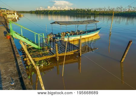 View of tourist boat in turquoise river water in Weston,Sabah,Borneo.Weston Wetland Park is one of the very large river-mouth wetlands in North Borneo.