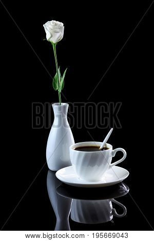 Composition With Cup Of Coffee And White Rose On A Black Reflective Background