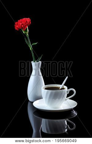 Composition With Cup Of Coffee And Red Carnation On A Black Reflective Background