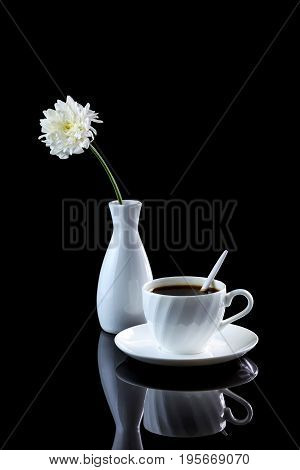 Composition With Cup Of Coffee And White Chrysanthemum On A Black Reflective Background