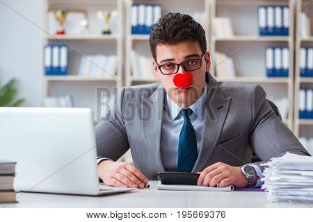Clown businessman tired sleepy in the office