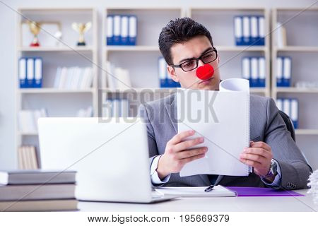 Clown businessman in the office